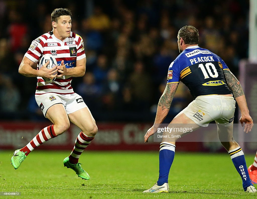 Jamie Peacock of Leeds Rhinos stands in the way of Joel Tomkins of Wigan Warriors during the Round 2 match of the First Utility Super League Super 8s between Leeds Rhinos and Wigan Warriors at Headingley Carnegie Stadium on August 14, 2015 in Leeds, England.