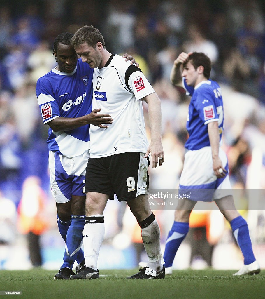 Jamie Peters of Ipswich puts his arm over Steve Howard of Derby after an interesting Coca-Cola Championship Match between Ipswich Town and Derby County at Portman Road on April 14, 2007 in Ipswich, England.