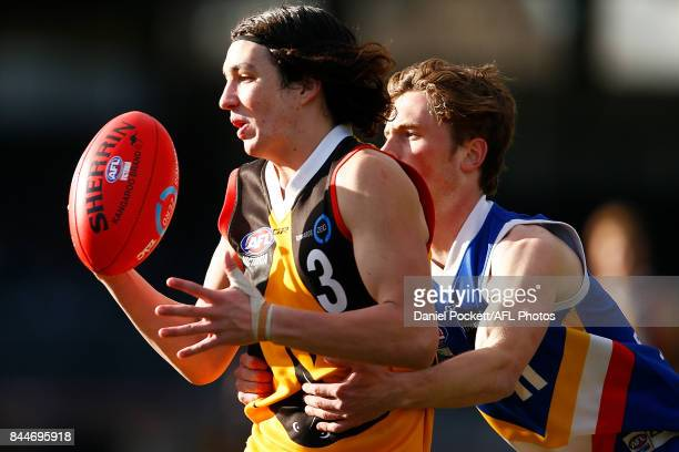 Jamie Plumridge of the Stingrays and Xavier Fry of the Ranges contest the ball during the TAC Cup Final between Dandenong and Eastern Ranges at...