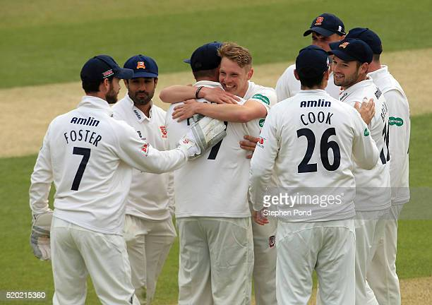 Jamie Porter of Essex celebrates a wicket with team mates during day one of the Specsavers County Championship match between Essex and...