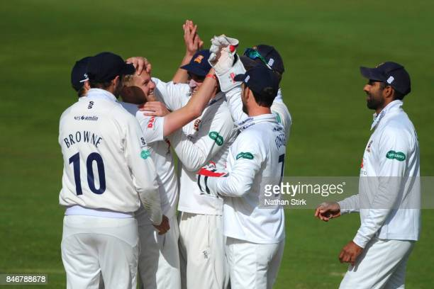 Jamie Porter of Essex celebrates with his team mates after getting Sam Hain of Warwickshire out during the County Championship Division One match...
