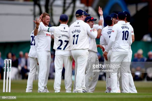 Jamie Porter of Essex celebrates with his teammates after dismissing Kumar Sangakkara of Surrey during the Specsavers County Championship Division...