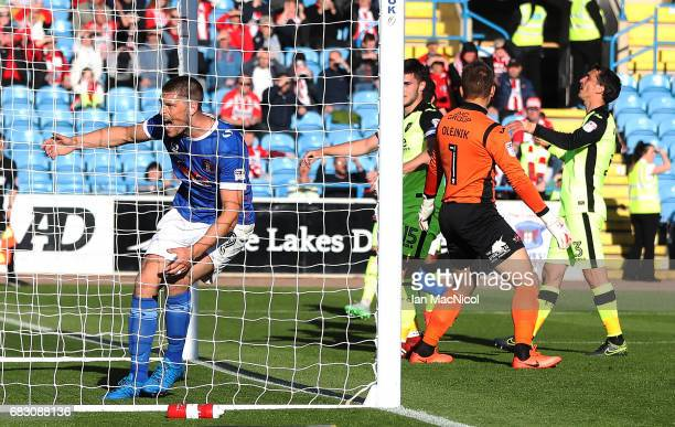 Jamie Proctor of Carlisle United celebrates after Nicky Adams of Carlisle United scores during the Sky Bet League Two match between Carlise United...
