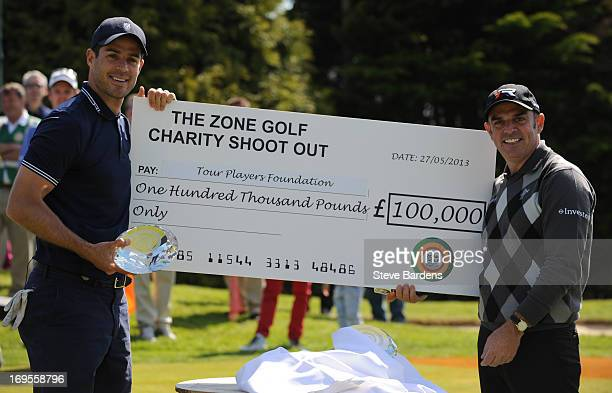 Jamie Redknapp and Paul McGinley with a giant cheque after their victory in the Zone Golf Charity Shoot Out event at Dukes Meadows par 3 course on...
