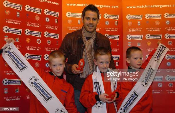 Jamie Redknapp and the triplet toy test team Reece Connor and Alexander Hoggard 9 years old unveil the new Matchmaster electronic football game at...