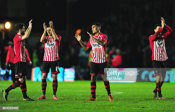 Jamie Reid of Exeter City celebrates the draw with team mates after the Emirates FA Cup third round match between Exeter City and Liverpool at St...