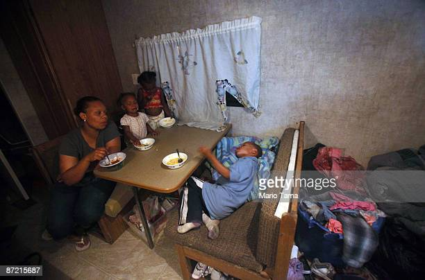 Jamie Riley eats dinner with three of her seven children in the FEMA Diamond trailer park May 13 2009 in Port Sulphur Louisiana Seven children and...