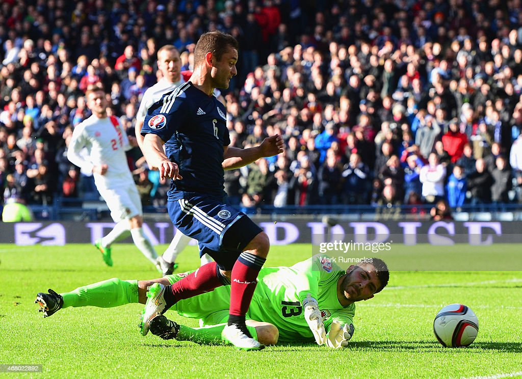Jamie Robba of Gibraltar brings down Shaun Maloney of Scotland during the EURO 2016 Qualifier match between Scotland and Gibraltar at Hampden Park on March 29, 2015 in Glasgow, Scotland.