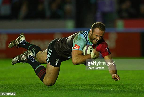 Jamie Roberts of Harlequins dives over to score a try on his Harlequins debut during the European Rugby Challenge Cup pool 3 match between Harlequins...