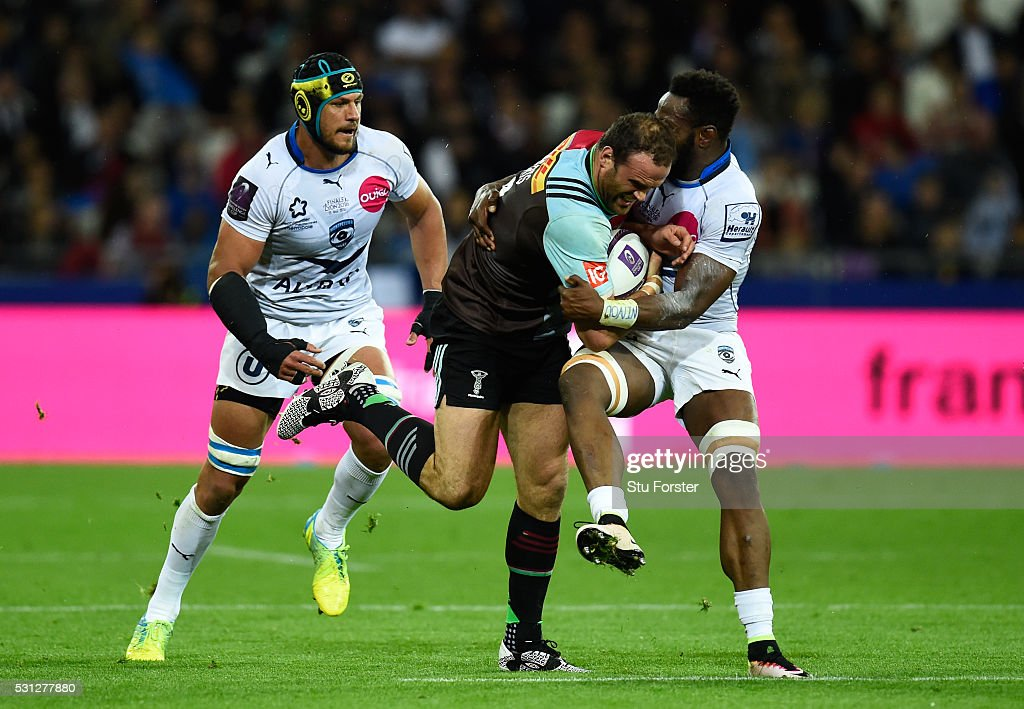 Jamie Roberts of Harlequins is tackled by Fulgence Ouedraogo of Montpellier during the European Rugby Challenge Cup Final match between Harlequins...
