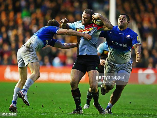 Jamie Roberts of Harlequins is tackled by Owen Farrell of Saracens during the Aviva Premiership match between Harlequins and Saracens at Twickenham...
