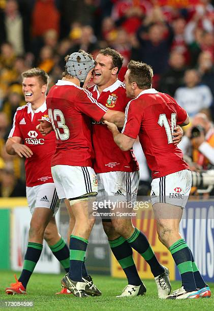 Jamie Roberts of the Lions and team mates celebrate after scoring a try during the International Test match between the Australian Wallabies and...