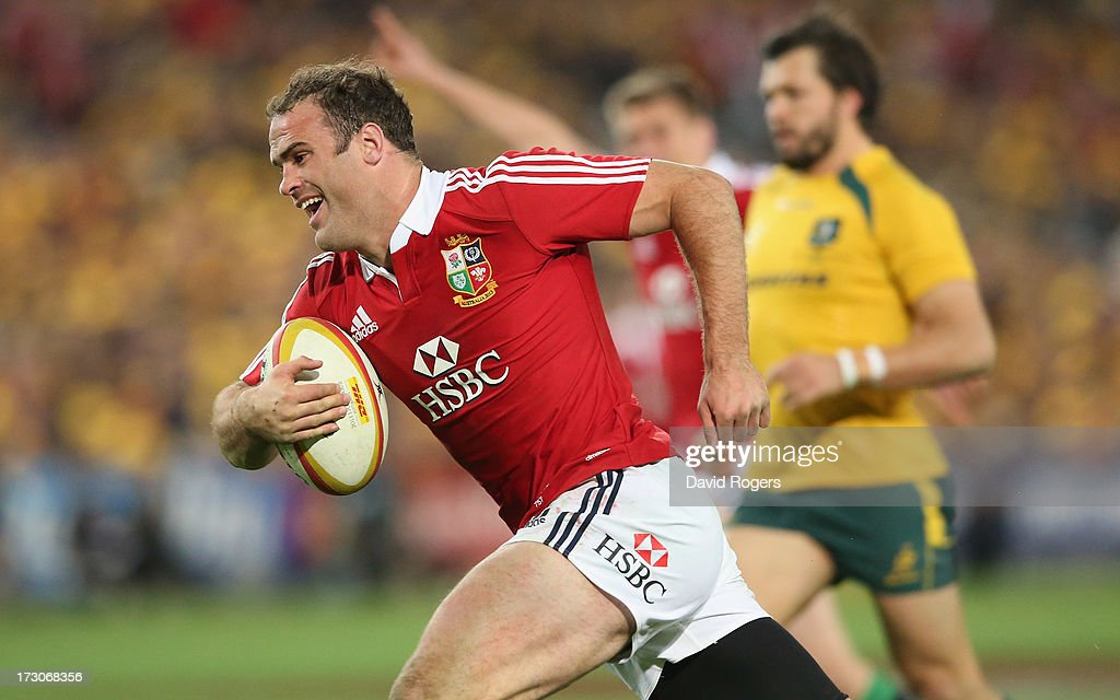 <a gi-track='captionPersonalityLinkClicked' href=/galleries/search?phrase=Jamie+Roberts&family=editorial&specificpeople=3530992 ng-click='$event.stopPropagation()'>Jamie Roberts</a> of the Lions breaks clear to score the Lions fourth try during the International Test match between the Australian Wallabies and British & Irish Lions at ANZ Stadium on July 6, 2013 in Sydney, Australia.