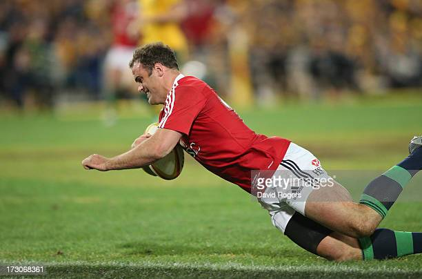 Jamie Roberts of the Lions dives over to score the Lions fourth try during the International Test match between the Australian Wallabies and British...