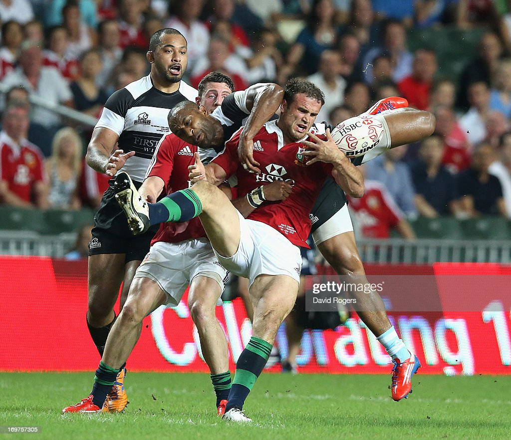Jamie Roberts of the Lions is challenged by Joe Rokocoko during the match between the British Irish Lions and the Barbarians at Hong Kong Stadium on...