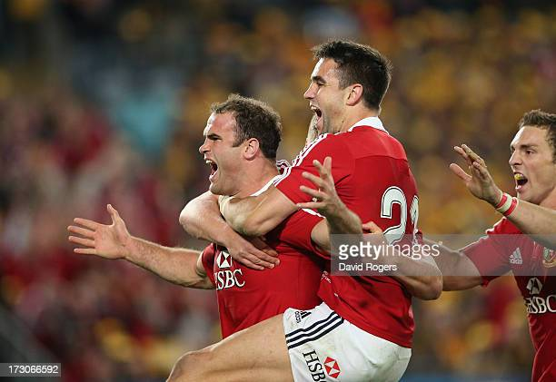 Jamie Roberts of the Lions is mobbed by team mates Conor Murray and George North after scoring the Lions fourth try during the International Test...