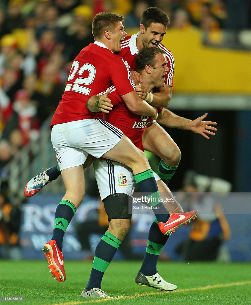 <a gi-track='captionPersonalityLinkClicked' href=/galleries/search?phrase=Jamie+Roberts&family=editorial&specificpeople=3530992 ng-click='$event.stopPropagation()'>Jamie Roberts</a> of the Lions is mobbed by team mates <a gi-track='captionPersonalityLinkClicked' href=/galleries/search?phrase=Conor+Murray+-+Rugby+Player&family=editorial&specificpeople=6820654 ng-click='$event.stopPropagation()'>Conor Murray</a> and <a gi-track='captionPersonalityLinkClicked' href=/galleries/search?phrase=George+North&family=editorial&specificpeople=7320853 ng-click='$event.stopPropagation()'>George North</a> after scoring the Lions fourth try during the International Test match between the Australian Wallabies and British & Irish Lions at ANZ Stadium on July 6, 2013 in Sydney, Australia.