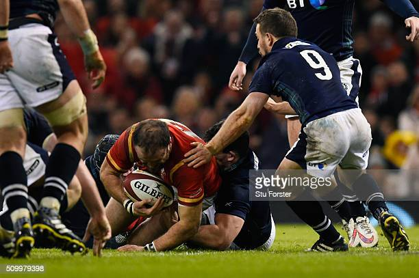 Jamie Roberts of Wales barges over to score his team's second try during the RBS Six Nations match between Wales and Scotland at the Principality...