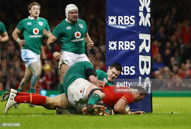 Jamie Roberts of Wales beats the Ireland defence as he scores their third try with George North during the Six Nations match between Wales and...