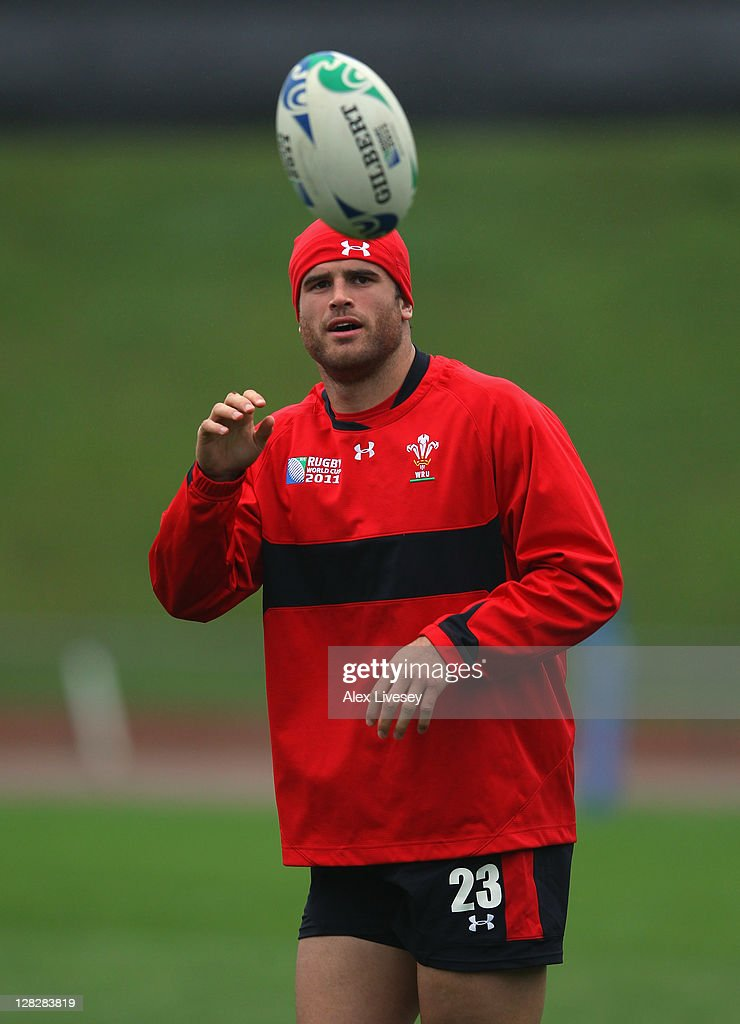 <a gi-track='captionPersonalityLinkClicked' href=/galleries/search?phrase=Jamie+Roberts&family=editorial&specificpeople=3530992 ng-click='$event.stopPropagation()'>Jamie Roberts</a> of Wales eyes the ball during a Wales IRB Rugby World Cup 2011 training session at Newtown Park on October 6, 2011 in Wellington, New Zealand.