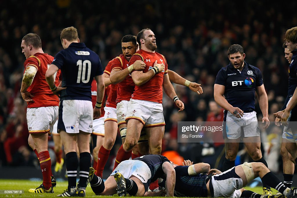 <a gi-track='captionPersonalityLinkClicked' href=/galleries/search?phrase=Jamie+Roberts&family=editorial&specificpeople=3530992 ng-click='$event.stopPropagation()'>Jamie Roberts</a> of Wales is congratulated by teammate <a gi-track='captionPersonalityLinkClicked' href=/galleries/search?phrase=Taulupe+Faletau&family=editorial&specificpeople=12444794 ng-click='$event.stopPropagation()'>Taulupe Faletau</a> of Wales after scoring his team's second try during the RBS Six Nations match between Wales and Scotland at the Principality Stadium on February 13, 2016 in Cardiff, Wales.