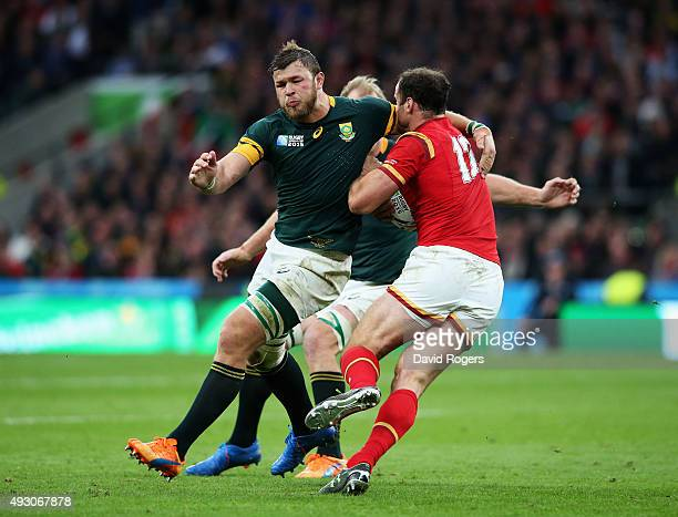 Jamie Roberts of Wales is tackled by Duane Vermeulen of South Africa during the 2015 Rugby World Cup Quarter Final match between South Africa and...