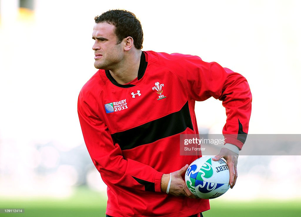 <a gi-track='captionPersonalityLinkClicked' href=/galleries/search?phrase=Jamie+Roberts&family=editorial&specificpeople=3530992 ng-click='$event.stopPropagation()'>Jamie Roberts</a> of Wales looks to offload the pass during a Wales IRB Rugby World Cup 2011 training session at Mt Smart Stadium on October 13, 2011 in Auckland, New Zealand.