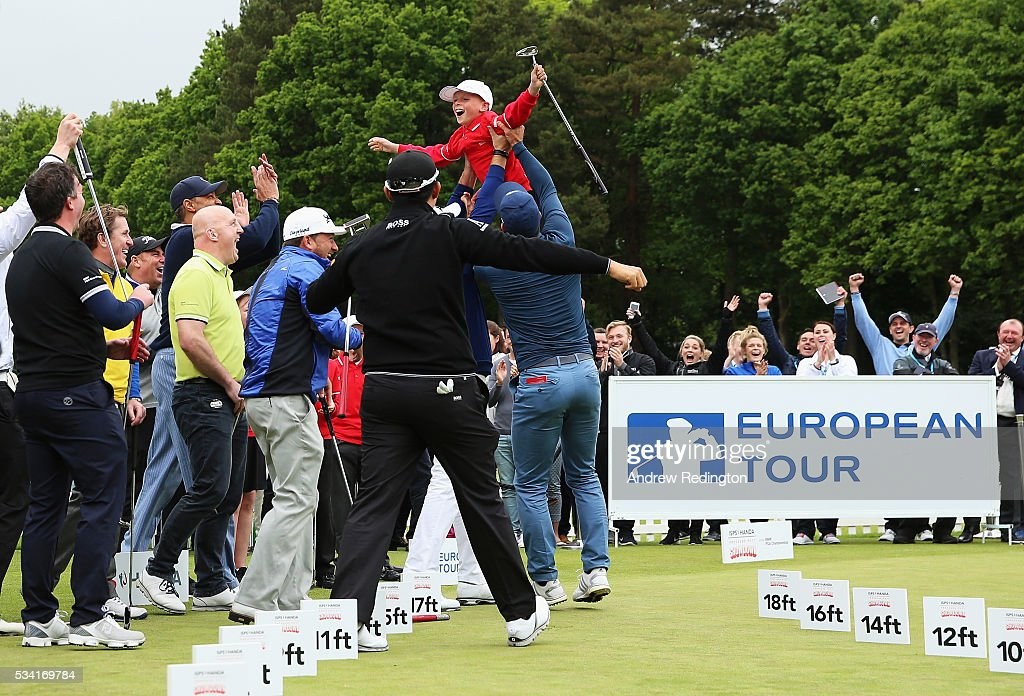 Jamie Sach aged 8 celebrates after holing a putt in the ISPS HANDA Pressure Putt Showdown prior to the BMW PGA Championship at Wentworth on May 25, 2016 in Virginia Water, England.