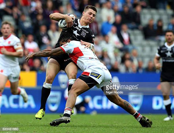 Jamie Shaul of Hull FC tackled by Albert Kelly of Hull KR during the First Utility Super League match between Hull FC and Hull KR at St James' Park...