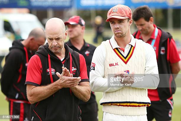 Jamie Siddons coach of the Redbacks and Travis Head captain of the Redbacks look on after losing the match on day 5 of the Sheffield Shield Final...