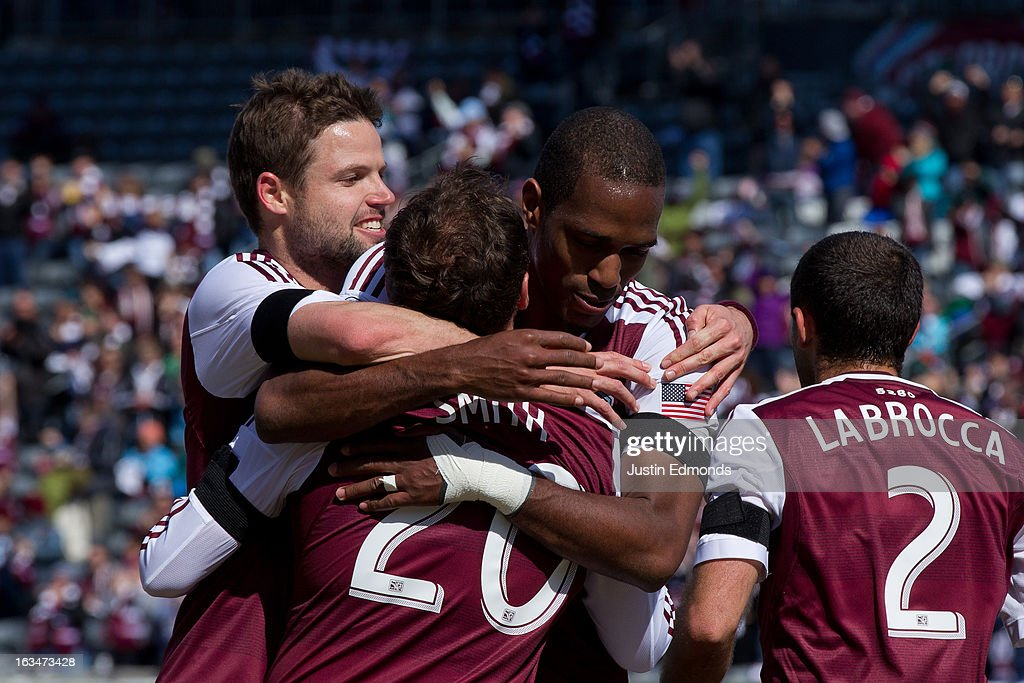 Jamie Smith #20 of the Colorado Rapids is congratulated by teammates after scoring a goal against the Philadelphia Union at Dick's Sporting Goods Park on March 10, 2013 in Commerce City, Colorado. The Union defeated the Rapids 2-1.