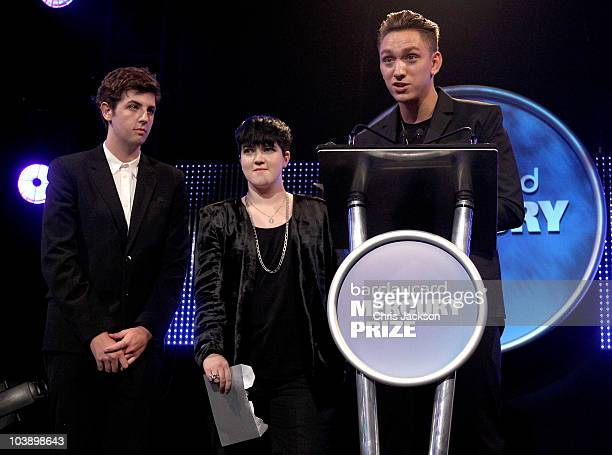 Jamie Smith Romy Madley Croft and Oliver Sim of The XX talk on stage after winning the Barclaycard Mercury Prize at the Grosvenor House Hotel on on...