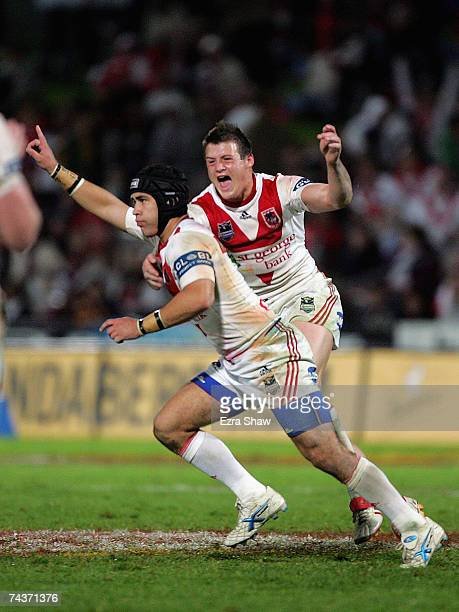 Jamie Soward and Josh Morris celebrate after Soward kicked a field goal with under two minutes to play to clinch the victory during the round 12 NRL...