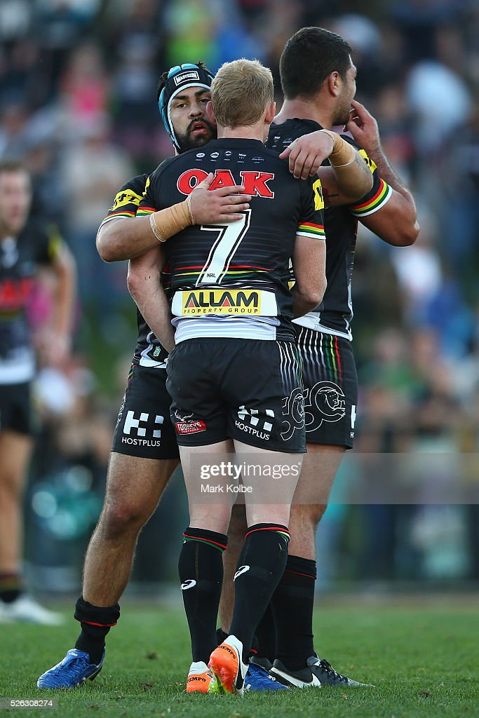 <a gi-track='captionPersonalityLinkClicked' href=/galleries/search?phrase=Jamie+Soward&family=editorial&specificpeople=2327643 ng-click='$event.stopPropagation()'>Jamie Soward</a> of the Panthers embraces Peter Wallace of the Panthers as they celebrate victory during the round nine NRL match between the Penrith Panthers and the Canberra Raiders at Carrington Park on April 30, 2016 in Bathurst, Australia.