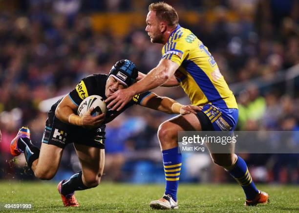 Jamie Soward of the Panthers is tackled by David Gower of the Eels during the round 12 NRL match between the Penrith Panthers and the Parramatta Eels...