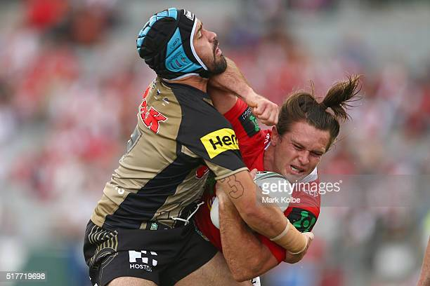 Jamie Soward of the Panthers tackle Mitch Rein of the Dragons during the round four NRL match between the St George Illawarra Dragons and the Penrith...