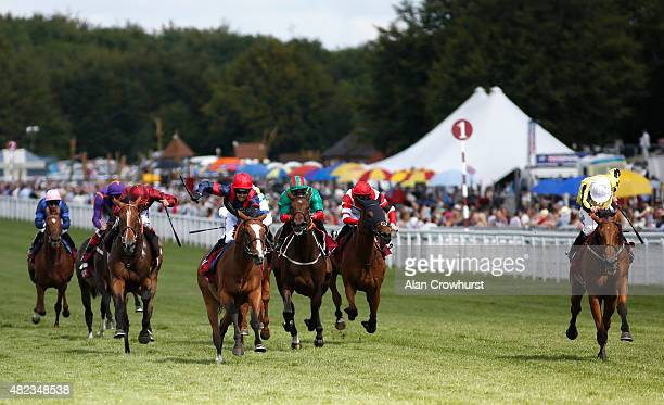 Jamie Spencer riding Big Orange win The Qatar Goodwood Cup at Goodwood racecourse on July 30 2015 in Chichester England
