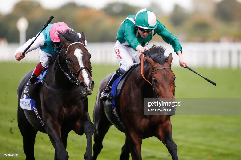 Jamie Spencer riding Raheen House (R) win The Londonmetric Noel Murless Stakes from Weekender and Frankie Dettori (L) after the original result was reversed at Ascot racecourse on October 6, 2017 in Ascot, United Kingdom.