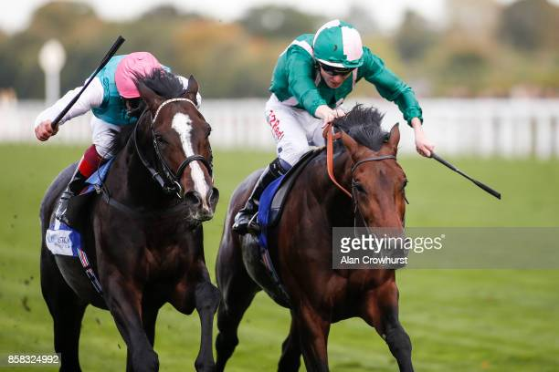 Jamie Spencer riding Raheen House win The Londonmetric Noel Murless Stakes from Weekender and Frankie Dettori after the original result was reversed...