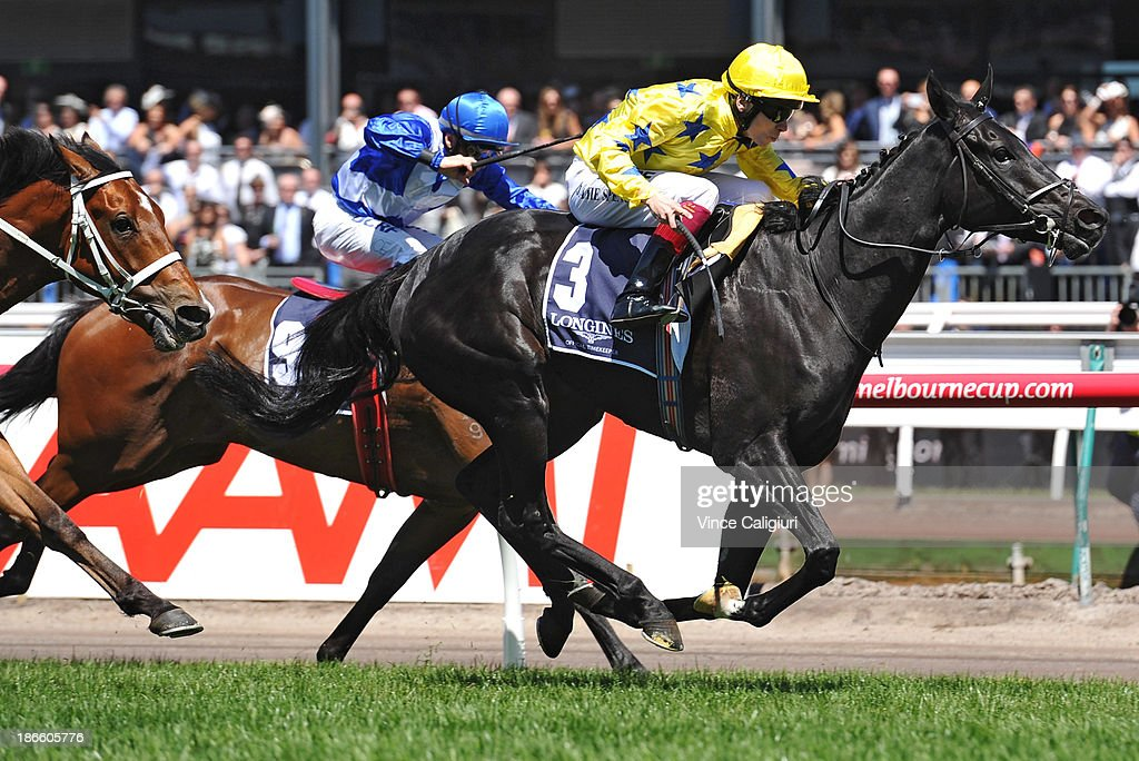 Jamie Spencer riding Side Glance wins Race 5 Longines Mackinnon Stakes during Derby Day at Flemington Racecourse on November 2, 2013 in Melbourne, Australia.
