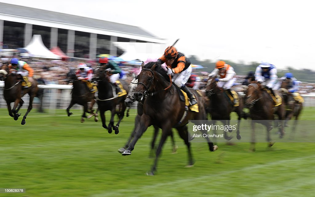Jamie Spencer riding Trade Storm win The Betfair. Don't Settle For Less Stakes at York racecourse on August 23, 2012 in York, England.