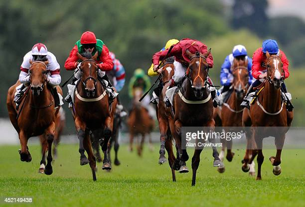 Jamie Spencer riding War Alert win The Reuben Foundation British Stallion Studs EBF Maiden Fillie' Stakes at Windsor racecourse on July 14 2014 in...