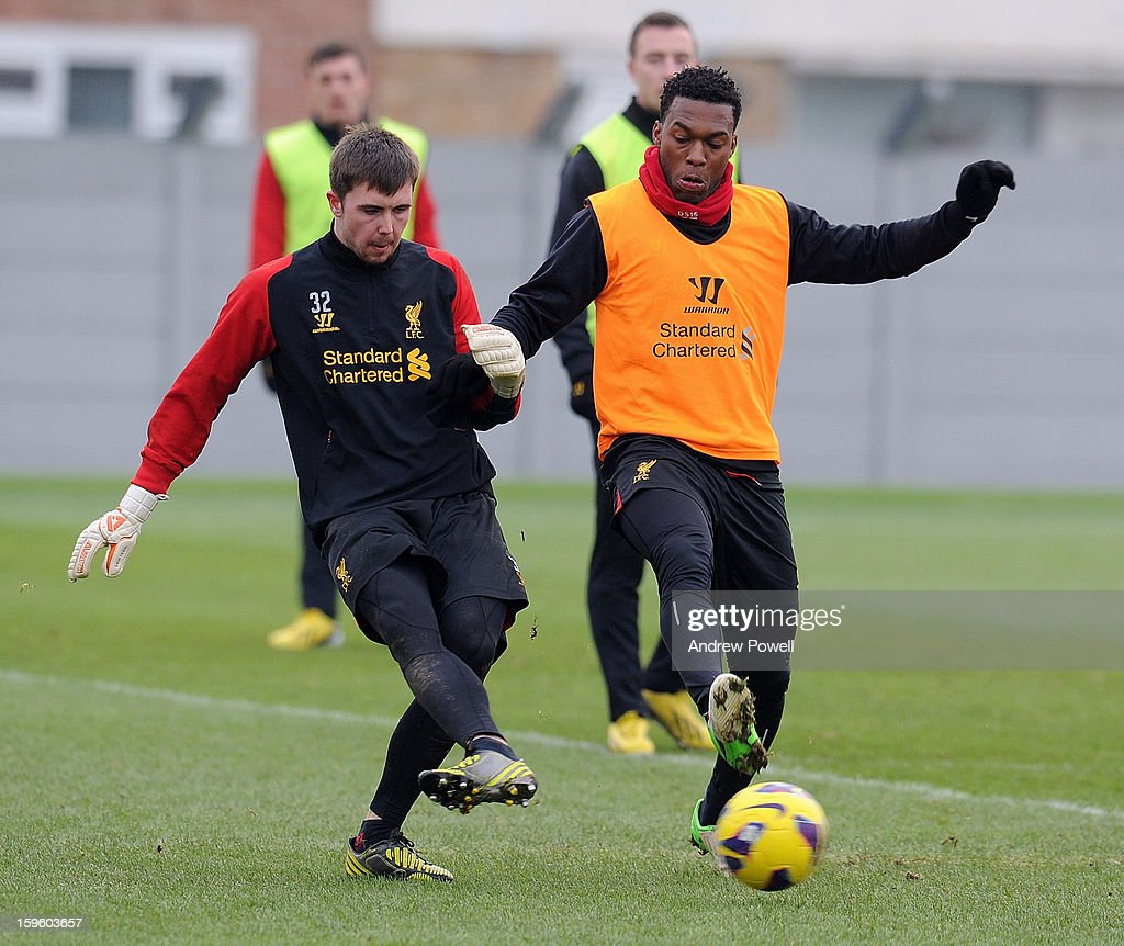 Jamie Stephens and <a gi-track='captionPersonalityLinkClicked' href=/galleries/search?phrase=Daniel+Sturridge+-+Soccer+Player&family=editorial&specificpeople=677270 ng-click='$event.stopPropagation()'>Daniel Sturridge</a> of Liverpool in action during a training session at Melwood Training Ground on January 17, 2013 in Liverpool, England.
