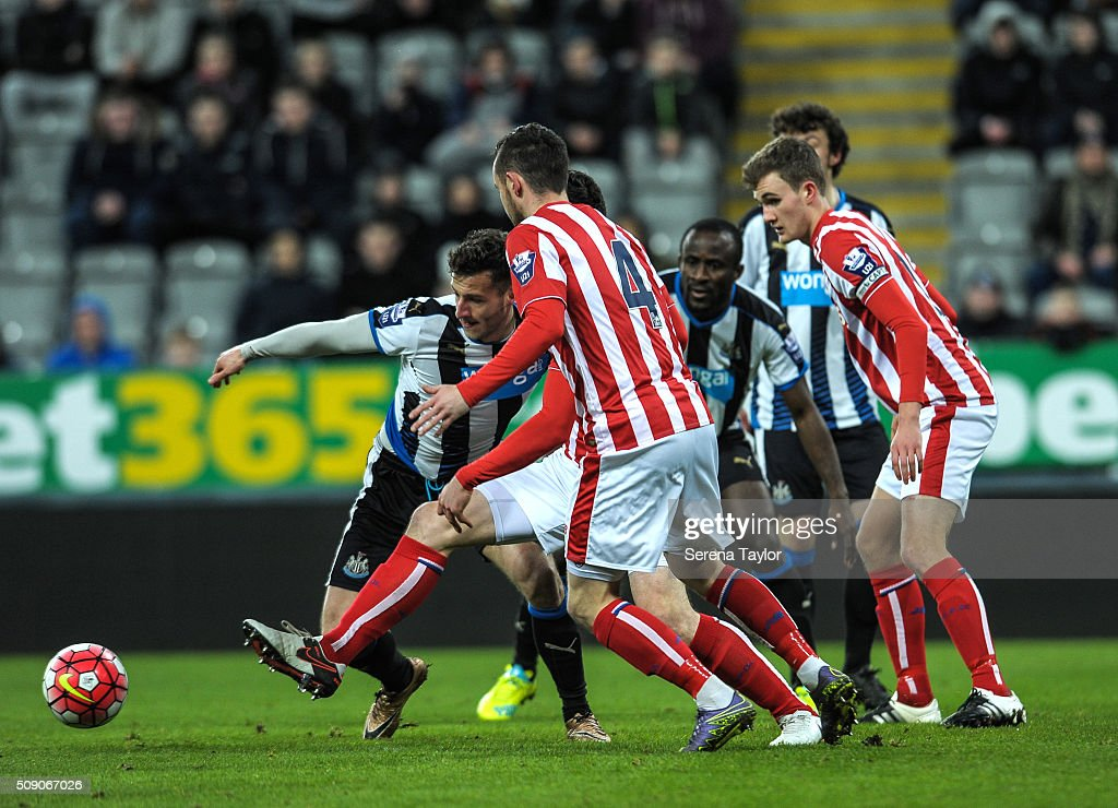 Jamie Sterry of Newcastle (L) passes the ball whilst being held back by a stoke player during the Barclays Premier League U21 match between Newcastle United and Stoke City at St.James' Park on February 8, 2016, in Newcastle upon Tyne, England.