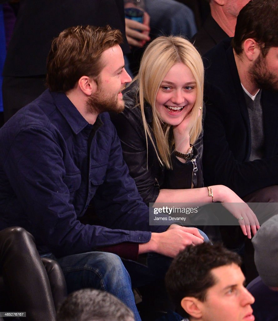 Jamie Strachan and <a gi-track='captionPersonalityLinkClicked' href=/galleries/search?phrase=Dakota+Fanning&family=editorial&specificpeople=203236 ng-click='$event.stopPropagation()'>Dakota Fanning</a> attend the Los Angeles Lakers vs New York Knicks game at Madison Square Garden on January 26, 2014 in New York City.