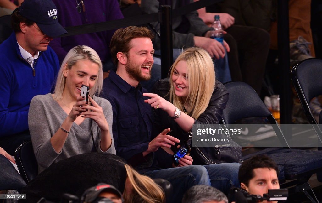 Jamie Strachan (C) and <a gi-track='captionPersonalityLinkClicked' href=/galleries/search?phrase=Dakota+Fanning&family=editorial&specificpeople=203236 ng-click='$event.stopPropagation()'>Dakota Fanning</a> (R) attend the Los Angeles Lakers vs New York Knicks game at Madison Square Garden on January 26, 2014 in New York City.