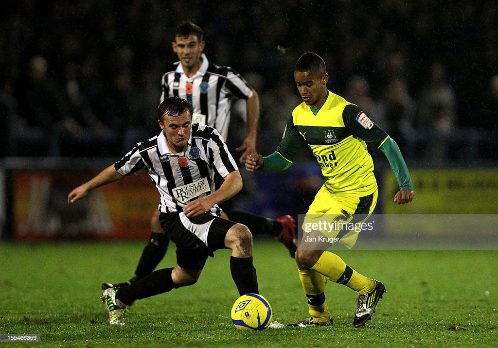 Jamie Symes of Dorchester Town competes with Paris Cowan-Hall of Plymouth Argyle during the FA Cup with Budweiser 1st Round match between Dorchester Town and Plymouth Argyle at The Avenue Stadium on November 4, 2012 in Dorchester, England.