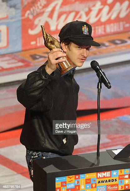 Jamie T receives the Music Moment Award his third award of the night at the NME Awards at Brixton Academy on February 18 2015 in London England