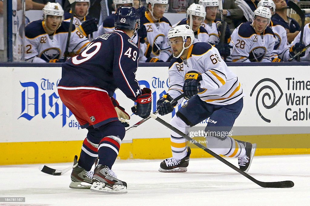 Jamie Tardif #68 of the Buffalo Sabres attempts to move the puck past Patrick McNeill #49 of the Columbus Blue Jackets on September 17, 2013 at Nationwide Arena in Columbus, Ohio.