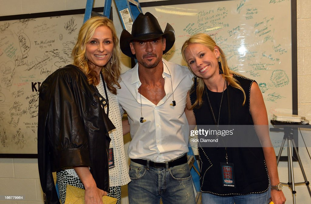 Jamie Tisch, Tim McGraw, and Shannon Rotenberg backstage during Keith Urban's Fourth annual We're All For The Hall benefit concert at Bridgestone Arena on April 16, 2013 in Nashville, Tennessee.